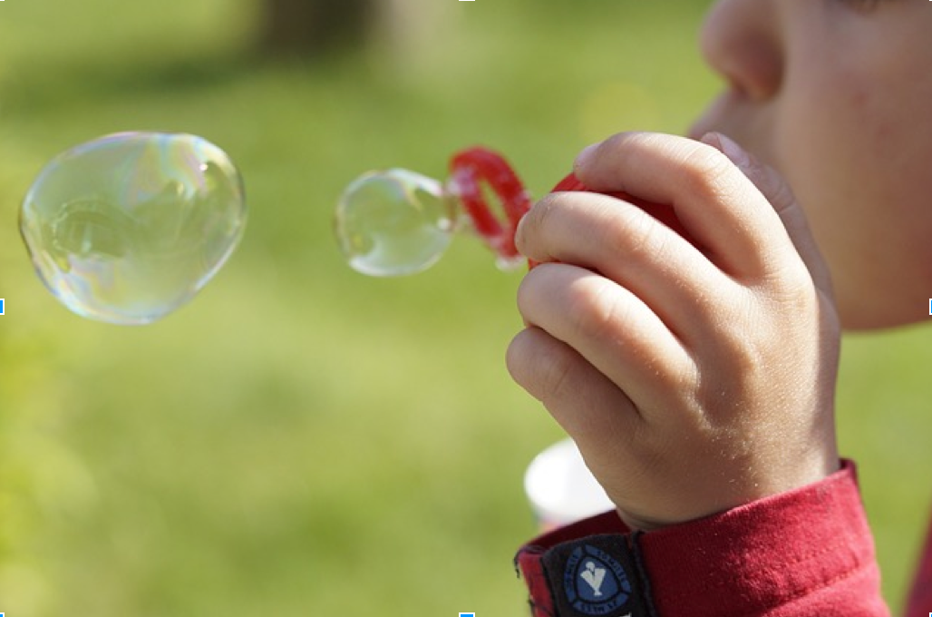 Picture of a child blowing bubbles